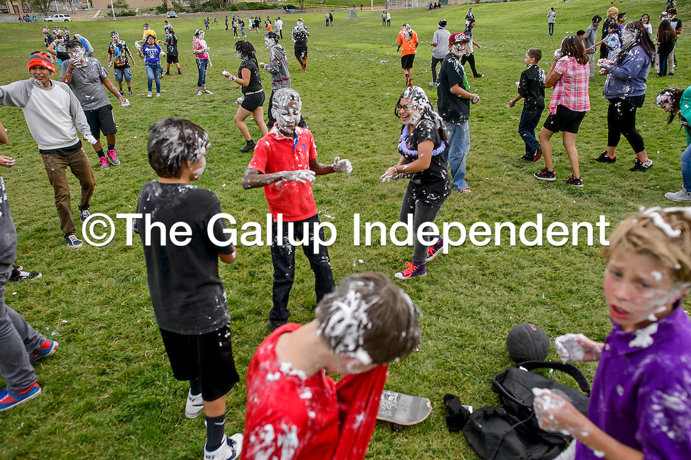 052715       Cable Hoover<br /> <br /> Middle and high school students smear each other with shaving cream during the annual shaving cream fight at Ford Canyon Park in Gallup Wednesday. The generations-old tradition celebrates the last day of classes for Gallup schools.