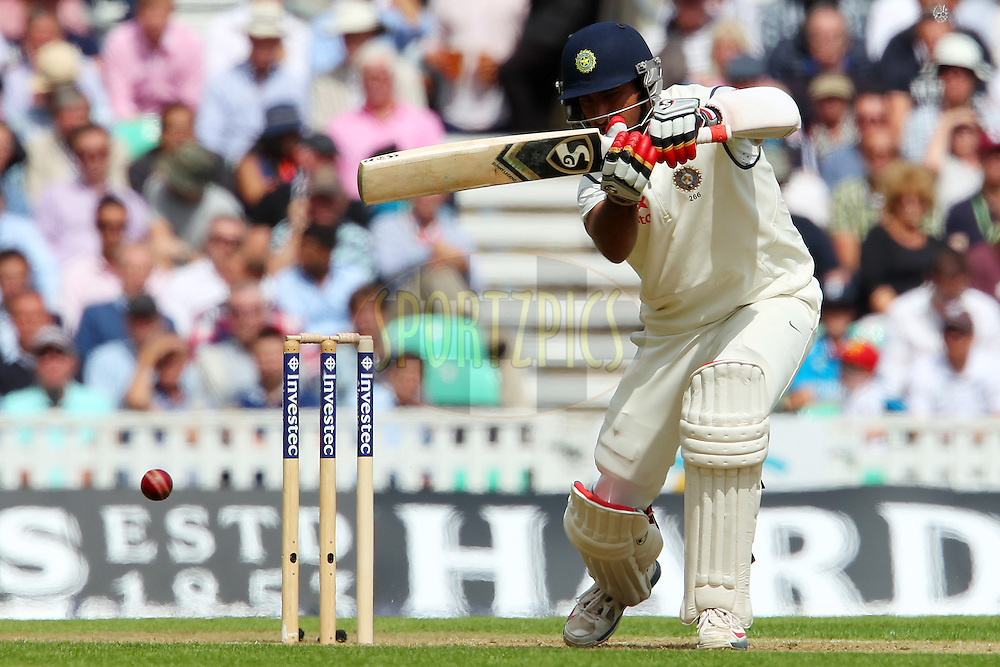 Cheteshwar Pujara of India during day one of the fifth Investec Test Match between England and India held at The Kia Oval cricket ground in London, England on the 15th August 2014<br /> <br /> Photo by Ron Gaunt / SPORTZPICS/ BCCI