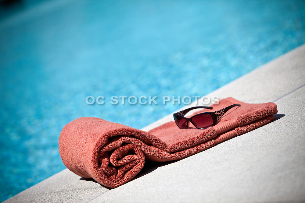 Sunglasses And Towel For The Pool