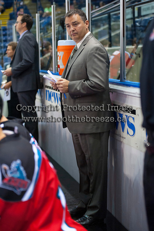 KELOWNA, CANADA - AUGUST 30:  Dan Lamert, head coach of the Kelowna Rockets stands on the bench during first period against the Kamloops Blazers on August 30, 2014 during pre-season at Prospera Place in Kelowna, British Columbia, Canada.   (Photo by Marissa Baecker/Shoot the Breeze)  *** Local Caption *** Dan Lambert;