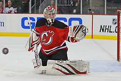 Feb 9; Newark, NJ, USA; New Jersey Devils goalie Johan Hedberg (1) watches the puck during the first period of their game against the St. Louis Blues at the Prudential Center.