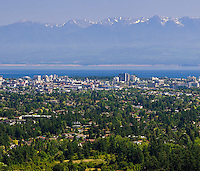 Panorama of the downtown core of Victoria, Olympic Mountains in the background.  Saanich, Vancouver Island, British Columbia, Canada.