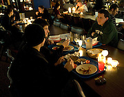 EthanBodenhorn, Michael Gospich and Nick Hurst enjoy the candlelight dinner held at Nelson Commons Wednesday.. ....Conservation Dinner: Wednesday, February 25th,  Nelson Dining Hall will enjoy the first candlelit dinner at Nelson