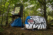 A disused caravan and shaft at he Nine Ladies protest camp at Stanton Lees, near Matlock in the Derbyshire Dales. The ancient woodland and Nine Ladies stone circle were threatened by a proposed quarry near the site. Following a nine year campaign by protesters the quarry proposal has now been rejected, and the camp will soon be dismantled and vacated.