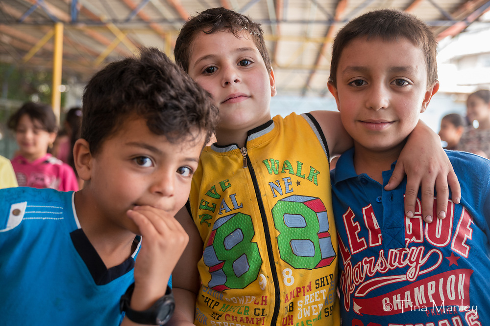 School in Tripoli for Syrian refugee children and interview with director and three Muslim mothers.