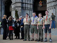 5 FEB. 2012 -- ST. LOUIS  -- Boy Scouts pose for photographs in front of the Cathedral Basilica of St. Louis following a Scout Sunday prayer service led by the Most Rev. Edward F. Rice, Auxiliary Bishop of the Archdiocese of St. Louis, Sunday, Feb. 5, 2012.  Photo © copyright 2012 Sid Hastings.
