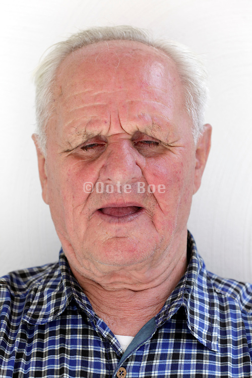 face of elderly 80 plus years man with eyes closed