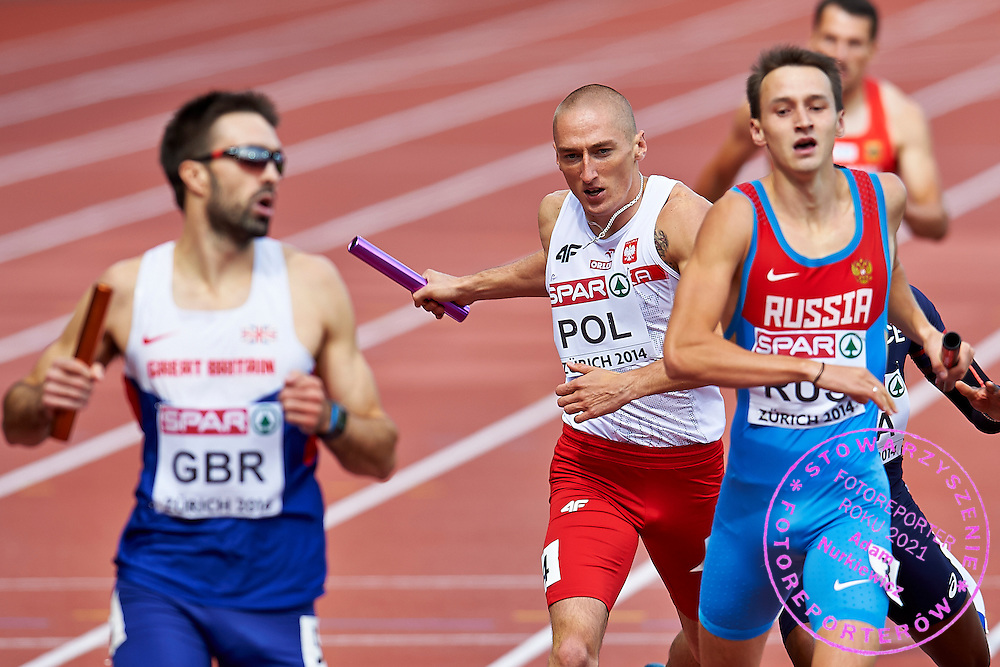 Jakub Krzewina from Poland competes in Men's Relay 4 x 400 meters final during the Sixth Day of the European Athletics Championships Zurich 2014 at Letzigrund Stadium in Zurich, Switzerland.<br /> <br /> Switzerland, Zurich, August 17, 2014<br /> <br /> Picture also available in RAW (NEF) or TIFF format on special request.<br /> <br /> For editorial use only. Any commercial or promotional use requires permission.<br /> <br /> Photo by &copy; Adam Nurkiewicz / Mediasport