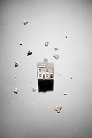 Smashed model house