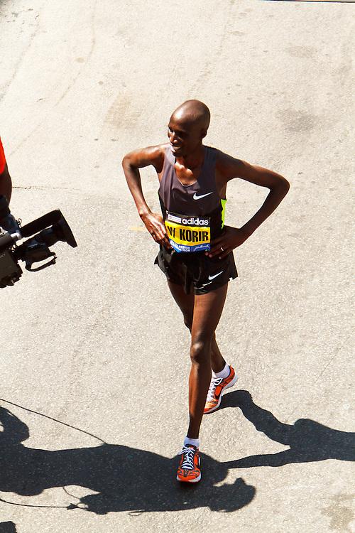 Wesley Korir walks off after victory