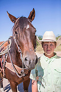 Colby McDonald and his bay mare horse at Warren Ranch at Katy Prairie Conservancy; Katy; Texas
