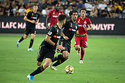 LAFC forward Carlos Vela (10) passes the ball to teammate  forward Diego Rossi (9) during a MLS soccer game between the LAFC and the Toronto FC. LAFC and Toronto FC tied 1-1 on Saturday, Sept 21, 2019, in Los Angeles. (Ed Ruvalcaba/Image of Sport)