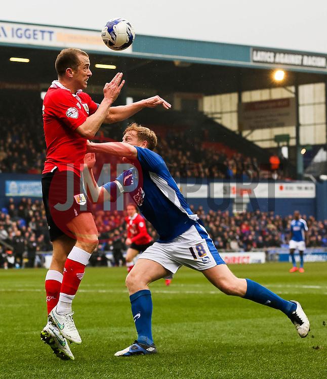 Bristol City's Aaron Wilbraham wins a header against Oldham Athletic's Adam Lockwood  - Photo mandatory by-line: Matt McNulty/JMP - Mobile: 07966 386802 - 03/04/2015 - SPORT - Football - Oldham - Boundary Park - Oldham Athletic v Bristol City - Sky Bet League One