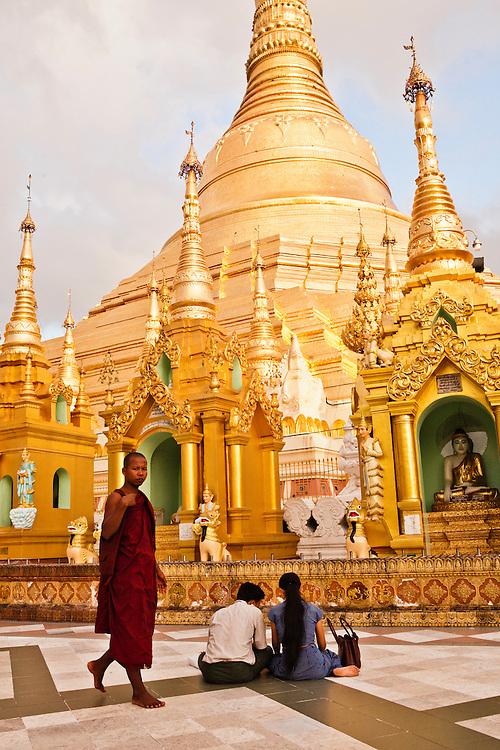 Worshipping at the Shwedagon Pagoda, Yangon, Myanmar.