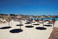 Lampedusa, Italia - 2 luglio 2011. Ombrelloni vuoti sulla spiaggia della Guitgia a Lampedusa. I gestori di attività commerciali legate al turismo e non solo lamentano un calo del 70% degli affari rispetto alle scorse stagioni estive dopo l'emergenza immigrazione dello scorso inverno..Ph. Roberto Salomone Ag. Controluce