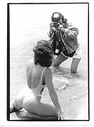 Mimi Lesseos (actress, film financier and champion wrestler) being photoggraphed by Rhonda Birndarf, Cannes Film Festival 1995© Copyright Photograph by Dafydd Jones 66 Stockwell Park Rd. London SW9 0DA Tel 020 7733 0108 www.dafjones.com