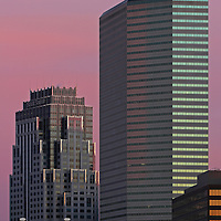Boston State Street architecture photography featuring a couple of iconic skyscrapers which are some of the tallest buildings in Boston. To the left is the beautiful Boston State Street Corporation and to the right is the One Financial Center at Dewey Square featured on a magnificent morning at dawn. This Boston skyline photo is available as museum quality photography prints, canvas prints, acrylic prints or metal prints. Fine art prints may be framed and matted to the individual liking and decorating needs:<br />
