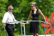 Legendary driver Mario Andretti shares a float with Miss America Katie Stam in the IPL 500 Festival Parade Saturday.