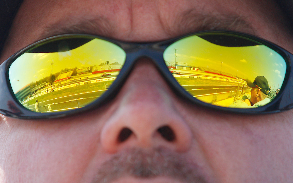 The race track at Atlanta Dragway is reflected in the glasses of Stephen Rhoads as two cars shoot down the track during the 29th annual NHRA Full Throttle Drag Racing Series on Thursday, April 16, 2009 in Braselton, Ga.