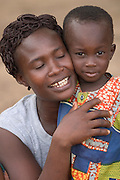 Togolese refugee woman and her child in a small village along the Togolese border, Eastern Ghana. Thousands of Togolese citizens crossed the border into Ghana after the violence that followed presidential elections in April 2005. Partly because of strong cultural ties between populations on both sides of the border, Togolese refugees were able to enjoy the relative hospitality of their Ghanaian neighbours, and are today scattered in various villages across the border. The UNHCR complains that, since the refugees aren't concentratred in large camps, media attention has been minimal, and that it has been very difficult to attract funding.