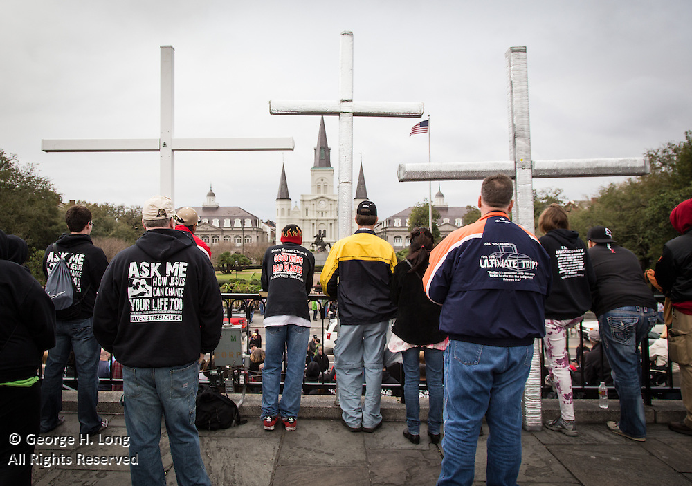 Members of the Raven Street Church in San Diego rest their crosses near Jackson Square on Mardi Gras