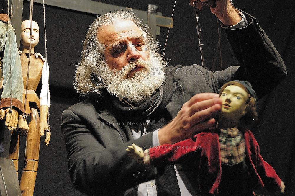 Mimmo Cuticchio in his workshop in Palermo with one of his puppet.Mimmo Cuticchio nel suo laboratorio a Palermo