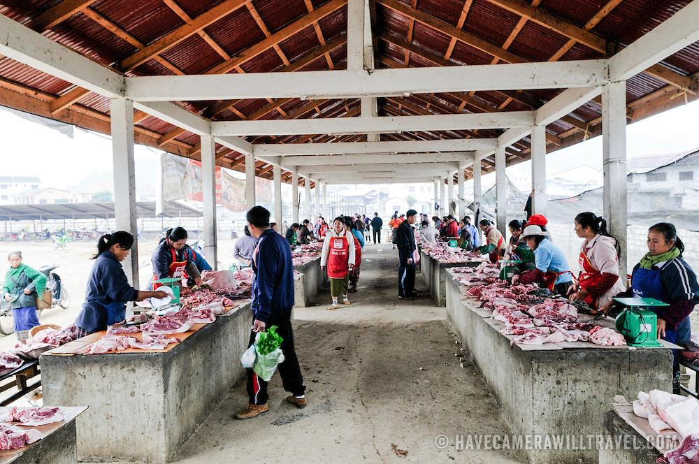 Fresh meat for sale at the morning market in Sam Neua (also spelled Samneua, Xamneua and Xam Neua) in northeastern Laos.