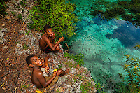 Kanak (Melanesian) boys, Natural Aquarium, Island of Mare, Loyalty Islands, New Caledonia