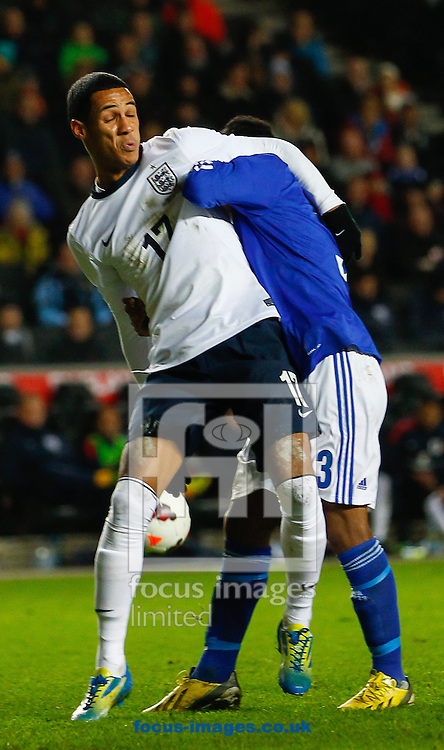 Picture by David Horn/Focus Images Ltd +44 7545 970036<br /> 14/11/2013<br /> Thomas Ince of England Under 21 and Felipe Aspegren of Finland U21 during the European U21 Championship match at stadium:mk, Milton Keynes.