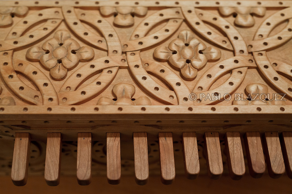 02/12/2016. A detail of an organistrum during an exhibition of musical instruments from medieval times recently made by luthiers at the Santa María la Real de Valdeiglesias Monastery on December 2, 2016 in Pelayos de la Presa, Madrid province, Spain. The Collegiate of Santa María la Mayor is a Romanesque architecture church built during the 12th and 13th centuries. Recents restorations of the Church discovered many details on its sculptures. Then luthiers started the project 'De la piedra a la madera' to recover and to reproduce the instruments displayed on the North Gate. (© Pablo Blazquez)