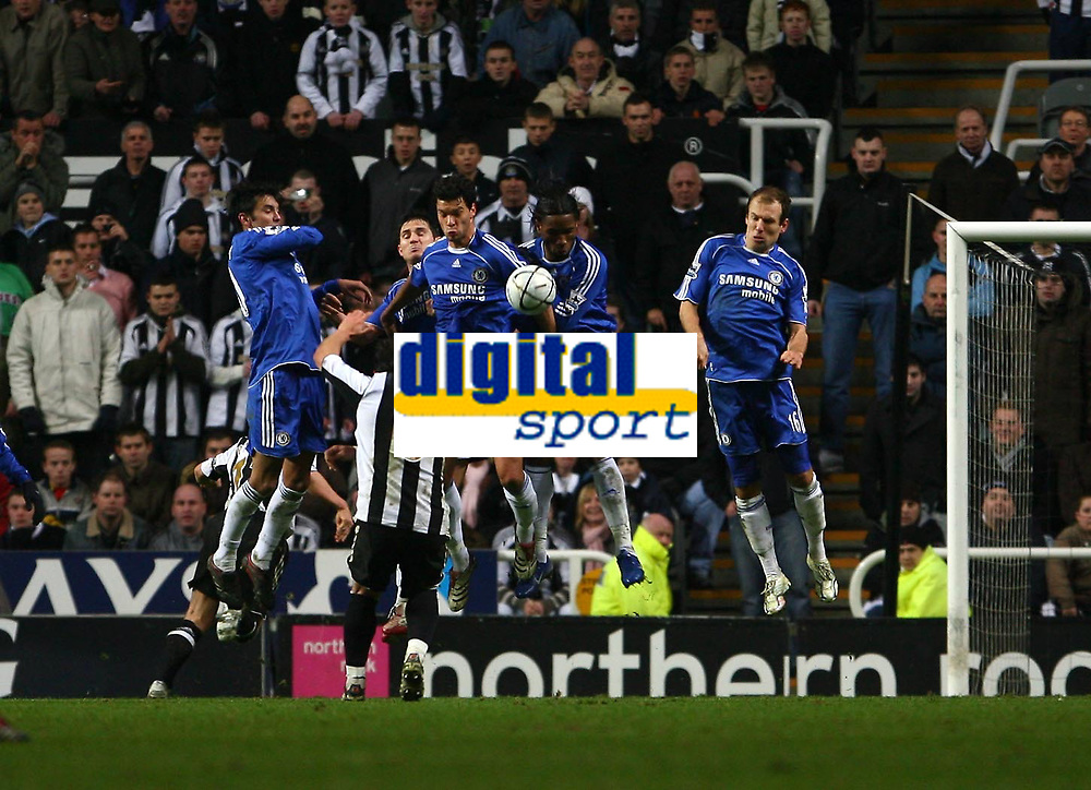 Photo: Andrew Unwin.<br /> Newcastle United v Chelsea. Carling Cup. 20/12/2006.<br /> The Chelsea wall does its job and blocks a free-kick from Newcastle's Emre.