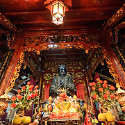 A large bronze statue is the centerpiece of the main shrine at Quan Thanh Temple in Hanoi. The statue, measuring nearly 4 meters tall and weighing nearly 4 tons was cast in 1677 and depicts Huyen Thien Tran Vo, the God who administered the North and after whom the temple was originally named. The Taoist temple dates back to the 11th century and is located close to West Lake (Ho Tay).