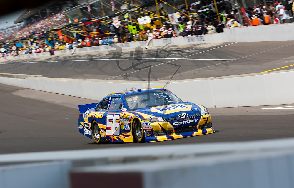INDIANPOLIS, IN - JUL 29, 2012:  Martin Truex, Jr. (56) brings his car down the front stretch during the Curtiss Shaver 400 presented by Crown Royal Sprint Cup Series race at the Indianapolis Motor Speedway in Indianapolis, IN.
