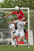 May 12, 2012; Huntsville, AL, USA;  Oak Mountain's David DePriest (9) goes for the ball over Auburn's Blake Boldt (12). Mandatory Credit: Marvin Gentry