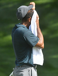 August 9, 2018 - St. Louis, Missouri, U.S. - ST. LOUIS, MO - AUGUST 09: Tiger Woods wipes his face before putting on the #15 green during the first round of the PGA Championship on August 09, 2018, at Bellerive Country Club, St. Louis, MO.  (Photo by Keith Gillett/Icon Sportswire) (Credit Image: © Keith Gillett/Icon SMI via ZUMA Press)