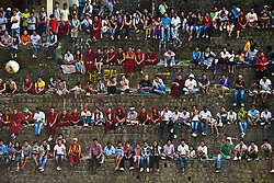 People watch Tibetan soccer match in McLeod Ganj, Dharamsala, India, where the Dalai Lama settled after fleeing Tibet in 1959 after a failed uprising against Chinese rule, June 1, 2009.