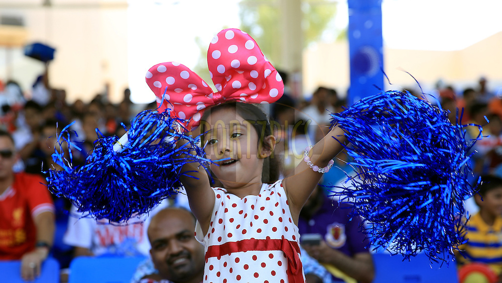 A Kid Enjoys  during match 16 of the Pepsi Indian Premier League 2014 between the Delhi Daredevils and the Mumbai Indians held at the Sharjah Cricket Stadium, Sharjah, United Arab Emirates on the 27th April 2014<br /> <br /> Photo by Sandeep Shetty / IPL / SPORTZPICS