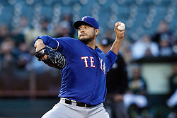 OAKLAND, CA - JUNE 14:  Martin Perez #33 of the Texas Rangers pitches against the Oakland Athletics during the first inning at the Oakland Coliseum on June 14, 2016 in Oakland, California. (Photo by Jason O. Watson/Getty Images) *** Local Caption *** Martin Perez