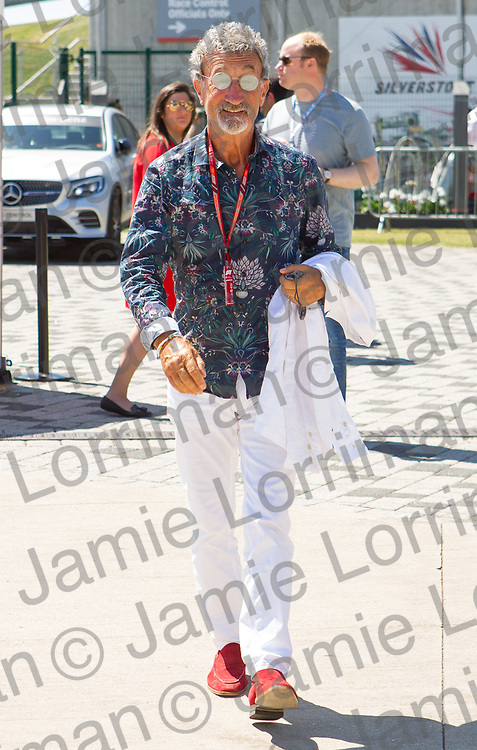 The 2018 Formula 1 F1 Rolex British grand prix, Silverstone, England. Sunday 8th July 2018.<br /> <br /> Pictured: Eddie Jordan walks through the paddock ahead of the race at Silverstone.<br /> <br /> Jamie Lorriman<br /> mail@jamielorriman.co.uk<br /> www.jamielorriman.co.uk<br /> 07718 900288