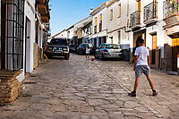 Kids play ball on the cobblestone streets of Ronda, a white hill town in the Andalusian region of Southern Spain.