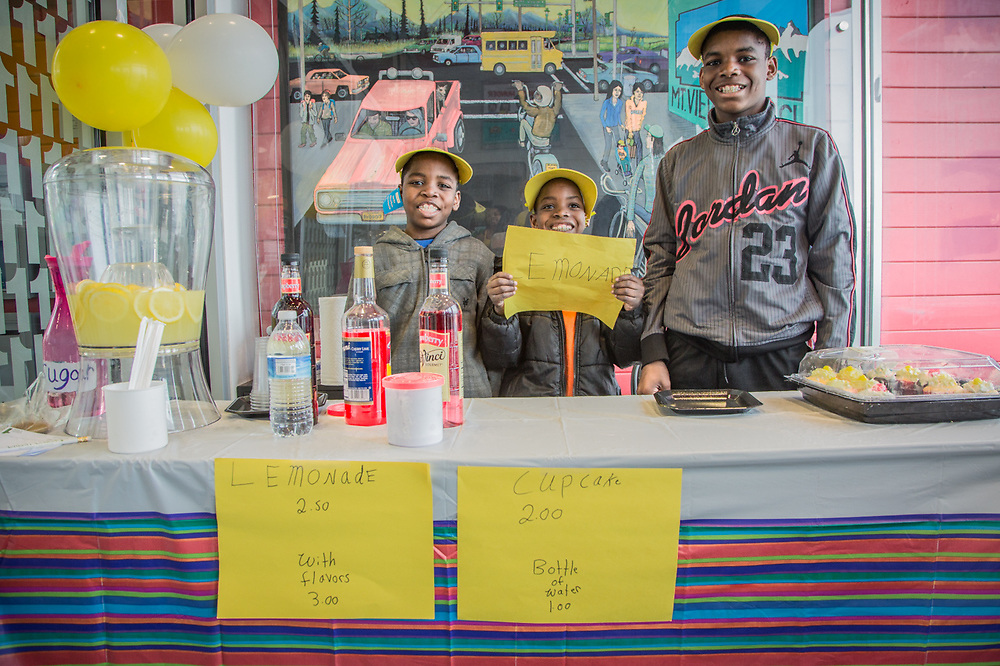 Brothers DeAndre, Macaeenan, and William Morgan, tend their Lemonade stand at Credit Union One in the Mountain View neighborhood of Anchorage