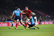 Scott Spedding (France's full back) getting tackled by two Italian players yet still managing to get the hand off during the Rugby World Cup Pool D match between France and Italy at Twickenham, Richmond, United Kingdom on 19 September 2015. Photo by Matthew Redman.