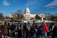 People gather at the reflecting pool by the U.S. Capitol ahead of Monday's inauguration of President Barack Obama on Sunday, January 20, 2013 in Washington, DC.