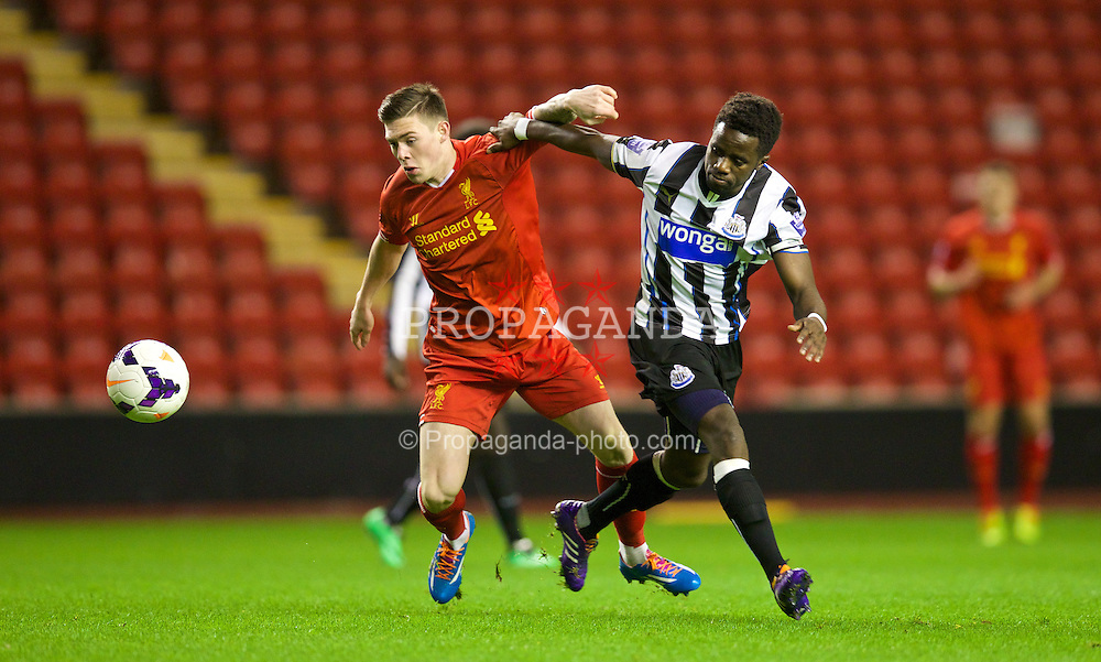 LIVERPOOL, ENGLAND - Friday, March 21, 2014: Liverpool's Jack Dunn wins the ball from Newcastle United's Gael Bigirimana to score the first equalising goal during the Under 21 FA Premier League match at Anfield. (Pic by David Rawcliffe/Propaganda)