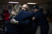 Cardiac survivor Steve Harmon embraces EMT Kristy Fryman as Harmon's wife, Sandy Harmon, embraces Kristy's husband T.J. Fryman after a clinical save commendation by EMS Captain Ashley Clousher during a cardiac save commendation ceremony at the Pleasant Hill Volunteer Fire Company Station, Monday, Dec. 3, 2018, in West Manheim Township. On July 7, 2018, the Frymans and PHRN Patricia Webb revived Harmon after he went into cardiac arrest.