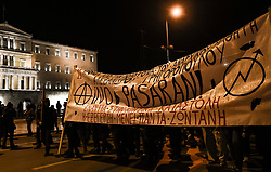 Protesters stand outside the Greek parliament during a demonstration,  in Athens, Greece on Friday, December. 6, 2019 commemorating the killing of 15-year-old student Alexandros Grigoropoulos by a police officer in 2008. Authorities are closing off main roads and have tightened security in the Greek capital.<br /> <br /> Pictured: <br /> Dimitris Lampropoulos    EEm date