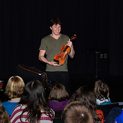 Joshua Bell meets with violin students from PMAC before he and Sam Haywood perform at The Music Hall in Portsmouth, NH on March 1, 2013.