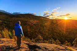 A man watches the sunset from Dome Rock in New Hampshire's White Mountain National Forest.