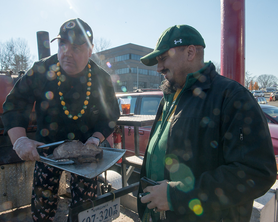 December 5, 2015 - Fairfax, VA - A day in the life of &quot;Doc Nix,&quot; aka Dr. Michael Nickens, the Director of the Athletic Bands for George Mason University. Here he meets 29 Diner John Wood who will present a check representing patrons donations to Nickens later at brunch.<br /> <br /> <br /> Photo by Susana Raab