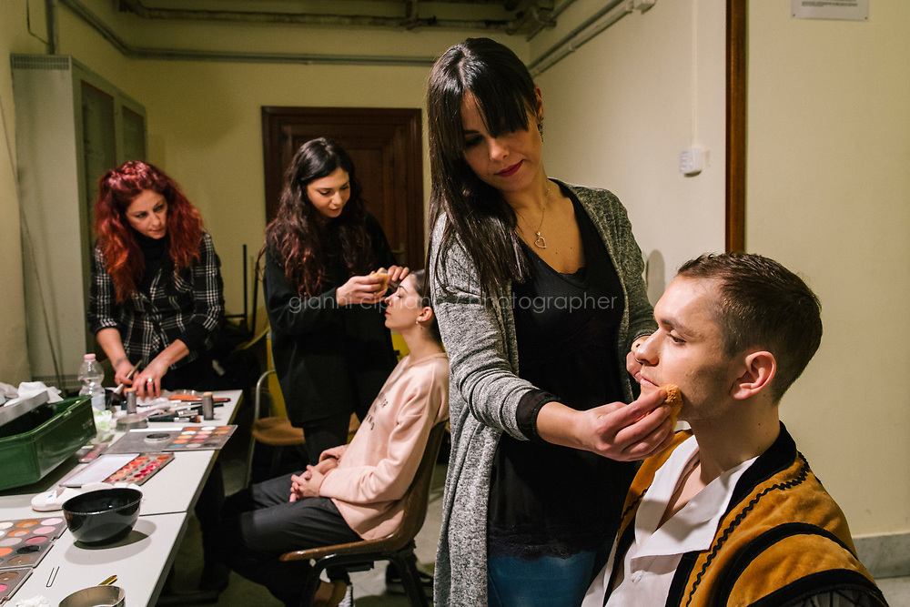 PALERMO, ITALY - 18 FEBRUARY 2018: Emilio Barone (right), who interprets the role of Sancho Panza in &quot;Don Quixote, has his make-up done by make-up artist Debora Giannetto shortly before the dress rehearsal at the Teatro Massimo in Palermo, Italy, on February 18th 2018.<br /> <br /> The Teatro Massimo Vittorio Emanuele is an opera house and opera company located  in Palermo, Sicily. It was dedicated to King Victor Emanuel II. It is the biggest in Italy, and one of the largest of Europe (the third after the Op&eacute;ra National de Paris and the K. K. Hof-Opernhaus in Vienna), renowned for its perfect acoustics. It was inaugurated in 1897.